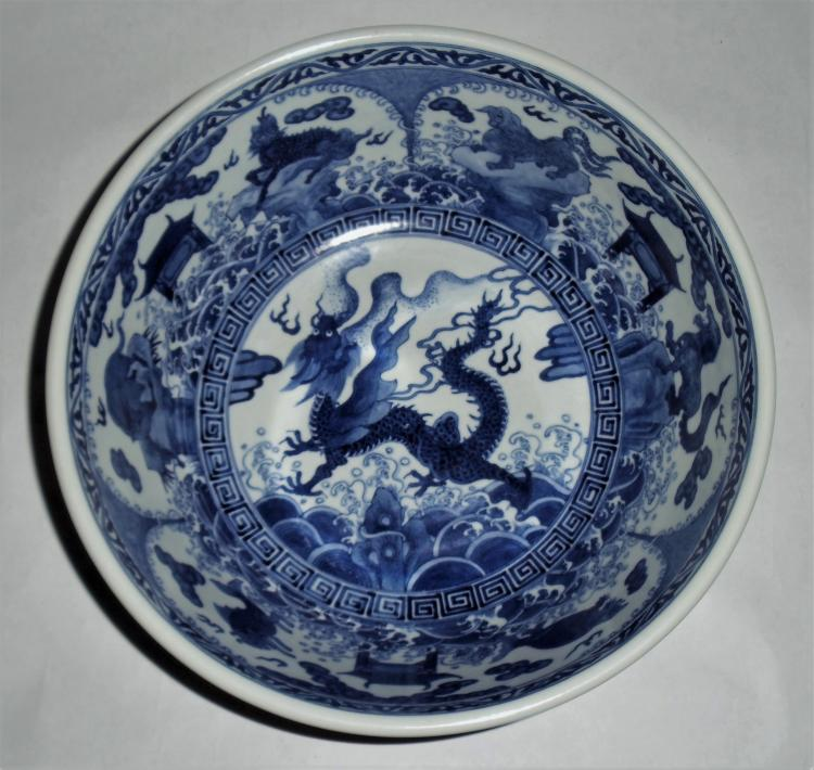A Rare Majestic Ming Dynasty Imperial Basin with Blue-White Motifs of Dragon amidst Windowed Mystic Beasts