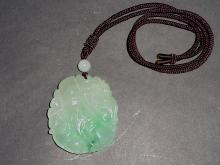 An Exquisite Jadeite Pendant with Auspicious Double-Monkey and Bamboo Motifs