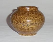 A Rare Song-Dynasty Pot with Jiaotai Motifs