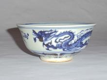 A Rare Yuan Dynasty Blue-White Bowl with Dragon-Lotus Motifs