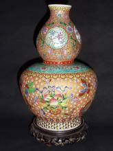 A Rare & Exquisite Qing Qianlong Famille Rose Gourd-Vase with Windowed Floral Motifs