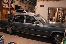 1985 Cadillac - Fleetwood Brougham - V8, blue with vinyl top. Four doors, one owner, 87,188 miles.
