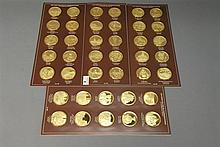 Forty sterling silver medals, electro plated in 24K gold in original shipping box, 1.03 t oz. each, approximately 41 t oz. total.