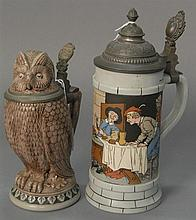 Two steins including Mettlach stein #2880 by F. Quiderus ht. 11in. and an owl stein marked 922 ht. 8 1/2in.