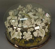 Victorian glass dome over bisque floral arrangement, dia. 19in.
