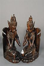 Pair of Balinese carved rosewood Guanyin figures, one sitting and one kneeling on lotus having NJANA Tilem Gallery stamp on bottom, ...