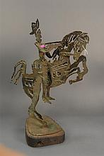 Large iron sculpture of a cowboy riding a horse, ht. 24in.