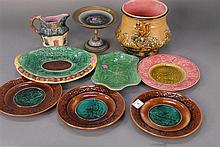 Nine piece Majolica lot to include plates, urn, compote, etc.