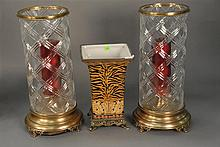 Three piece lot to include pair of crystal hurricane type candle holders ht. 19in. and a vase ht. 12 1/2in.