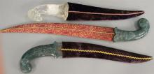 Three Asian daggers including two with carved jade handles (lg. 16in. & 20in.) and one with rock crystal ram's head handle (lg. 15 1..
