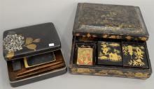 Two black lacquered boxes including writing or calligraphy box Suzuribako with heavy gold leaves and mother of pearl decoration open...