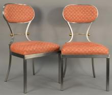 Set of eight custom steel chairs with upholstered seat and back and brass trim. ht. 36in.