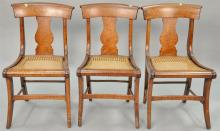 Set of three tiger maple cane seat chairs, circa 1840.
