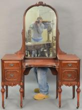 Two piece lot to include a mahogany vanity with mirror ht. 67in., wd. 49 1/2in. and a Chippendale style wing chair.  Provenance: P...