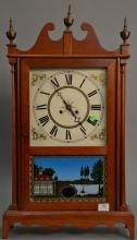 Reproduction pillar and scroll style clock. ht. 31 1/2 in., wd. 17 in.