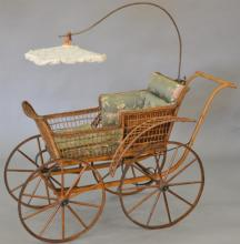 Wicker carriage with lacy parasol