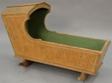 Primitive cradle in original paint, late 18th to early 19th century. ht. 25 in., lg. 36 in.