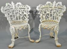 Pair of Victorian iron side chairs having floral and leaf backs with openwork seats. height 32 1/2 inches Provenance: Property fr...