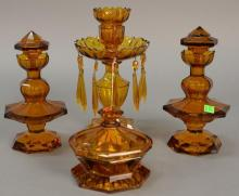 Four piece amber glass set, pair of crystal bottles (ht. 8in.)and jar marked Czechoslovakia, along with candlesticks with prisms (ht...