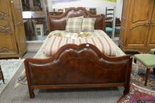 Contemporary queen size bed with leather upholstered foot and headboard. ht. 52 1/2in.