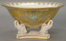 French porcelain center bowl, oval form gilt decorated with eagle and crown set on four swan unglazed porcelain base on plain footed...