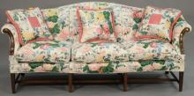 Custom Federal style mahogany camelback sofa with down filled cushions, rolled arms, and custom floral upholstery. ht. 40in., wd. 90in.