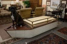 Contemporary boat shaped youth bed with brass rails. ht. 23in., lg. 86in., wd. 34in.