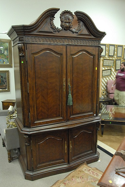 "Large TV cabinet/Armoire four doors in two parts, ht. 92"", wd. 55"", dp. 23""."