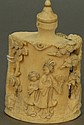 Large ivory snuff bottle with carved tree on each side and two Guanyin figures on front. ht. 3 1/2in.