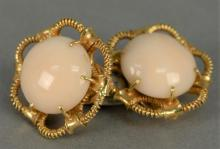 18K clip on earrings, each set with large cabochon cut light pink coral. total weight 18.4 grams