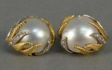 14K clip on earrings, set with large pearls, fern design and ten diamonds. total weight 19.4 grams