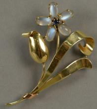 14K Tiffany brooch, floral design set with moonstones and blue sapphire. ht. 3in. 14.9 grams