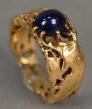 18K ring with reticulated bird design set with cabochon cut blue sapphire.  8.5 grams, size 5 1/2