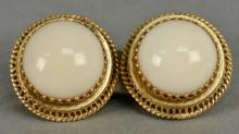 Pair of 14K gold clip earrings, each set with cabochon cut coral. total weight 17.6 grams