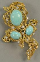 18K free form brooch set with three cabochon cut turquoise and 14 diamonds. total weight 40.7 grams