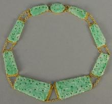 20K gold and carved light green jade necklace, jade panels carved with birds, flowers, and vines. lg. 16in.