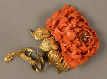 14K gold and coral brooch carved coral in form of large flower set with four small diamonds. ht. 3 1/2in., total weight 46.8 grams