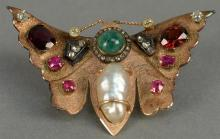 14K butterfly pin set with diamonds, rubies, emerald, and pearl. wd. 2 1/4in. 14.3 grams