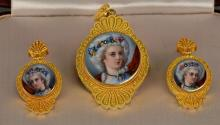 18K-20K and French enamel suite comprising of a brooch and a pair of earrings, each having enameled portrait of maiden mounted with ...