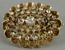 Georgian 10K gold oval form brooch set with 35 rose cut diamonds, 19th century or earlier.