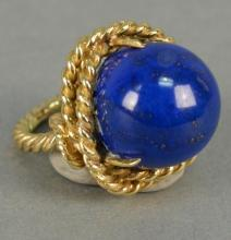 18K ring with large cabochon cut lapis, ring in rope design.  total weight 19.5 grams