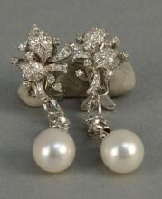18K white gold drop earrings set with diamonds and one pearl. ht. 1 3/4in.