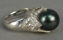 Mikimoto platinum ring set with large black pearl 12mm surrounded by diamonds. total weight 20.7 grams