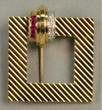 14K Tiffany & Co. buckle style brooch set with five rubies and six diamonds. total weight 14.7 grams