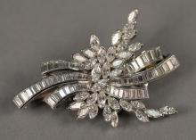 Platinum and diamond brooch/pendant set with marquis and baguette diamonds approximately 4ct. total weight.