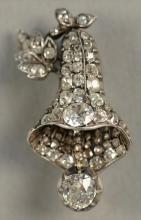 14K white gold brooch in form of a bell encrusted with diamonds including one diamond approximately .70cts and one approximately .60...