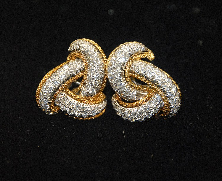Pair of 18K gold and platinum diamond earrings, each mounted with 58 diamonds, approx. total weight 4cts. 19.8 grams