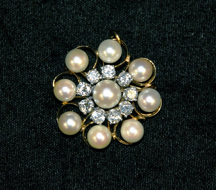 14K gold pin/pendant set with nine cream colored pearls and nine brilliant cut diamonds approx. .20cts each. total diamond weight:.....