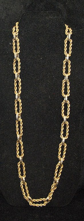 14K gold chain made from rings of rope style chain connected by 14K white gold bands. 110.2 grams