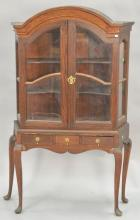 Mahogany curio cabinet in two parts. ht. 62in., wd. 38in., dp. 12in.